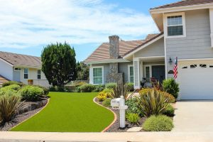artificial turf installed in San Diego two-story home front yard near entrance