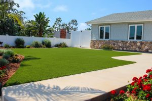 Artificial turf in backyard with patio furniture near home
