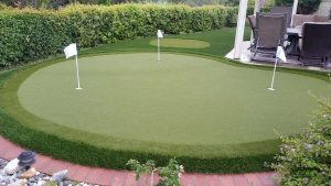 Putting Green in backyard next to patio