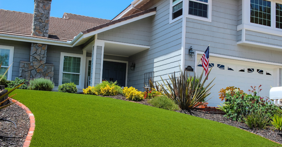 front yard of home with artificial turf