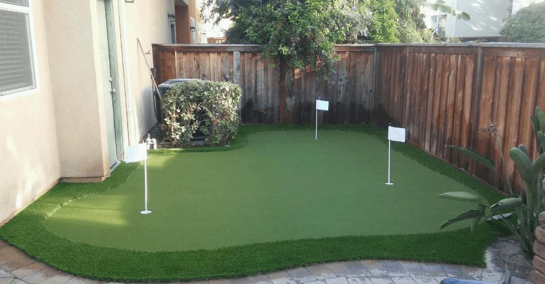 artificial turf putting green in a backyard