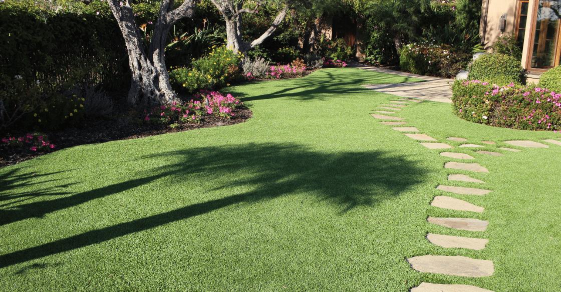 artificial turf around stone pavers