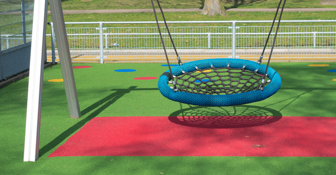 Playground with synthetic grass