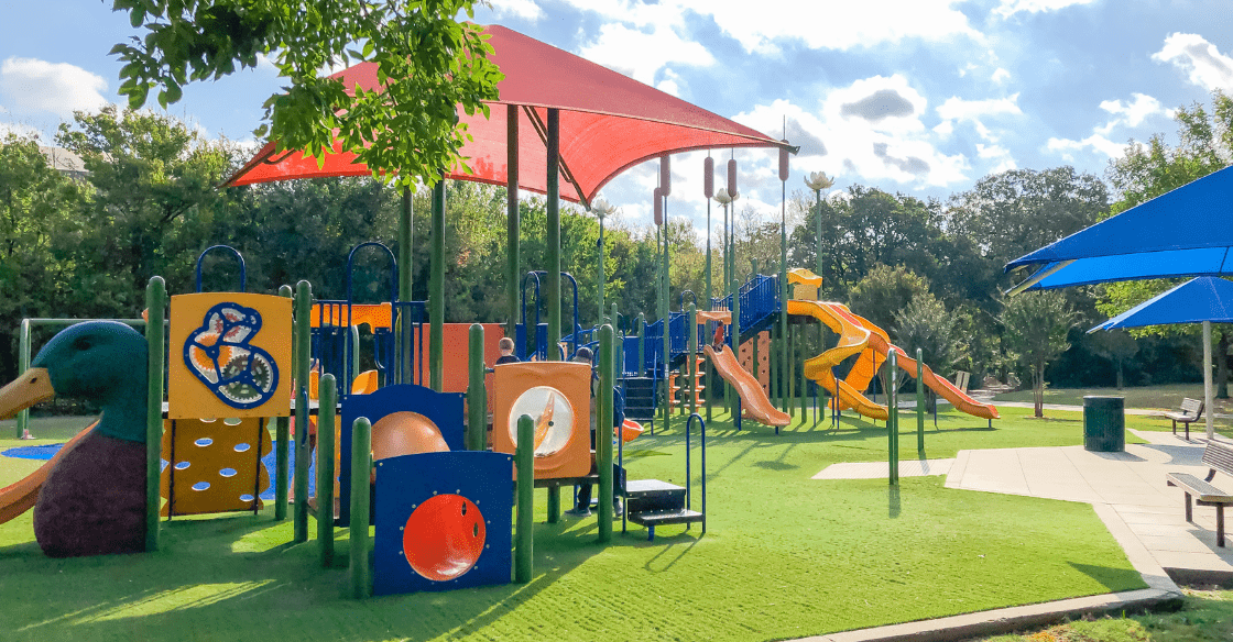 playground with artificial grass on a sunny day