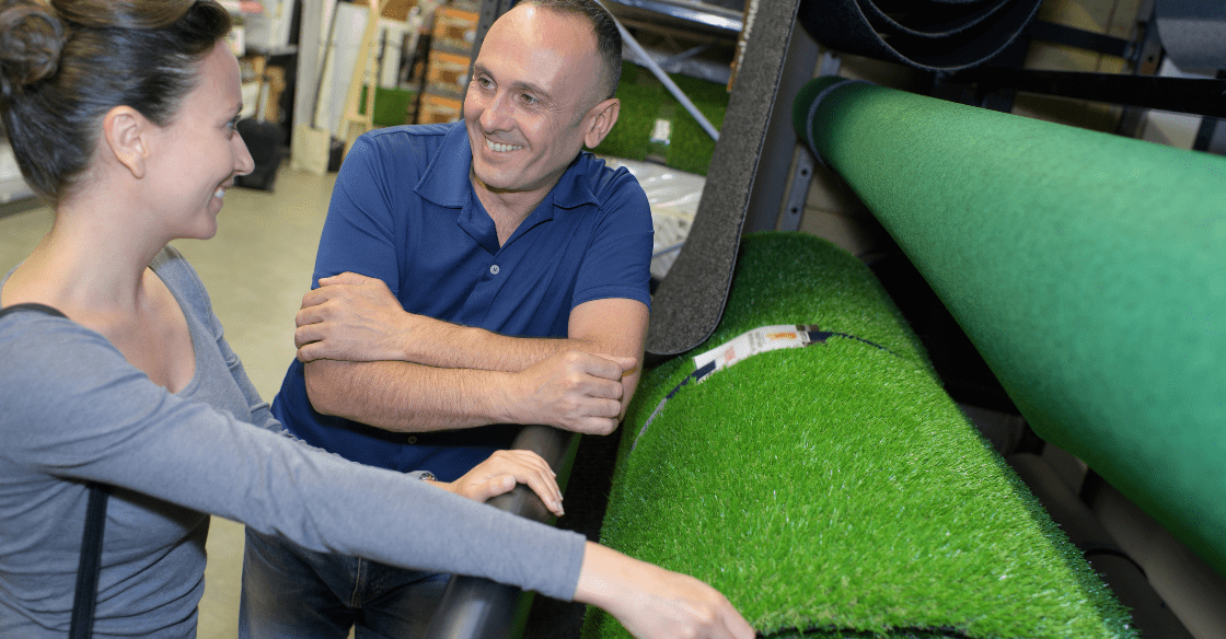 Customer selecting from different types of artificial turf