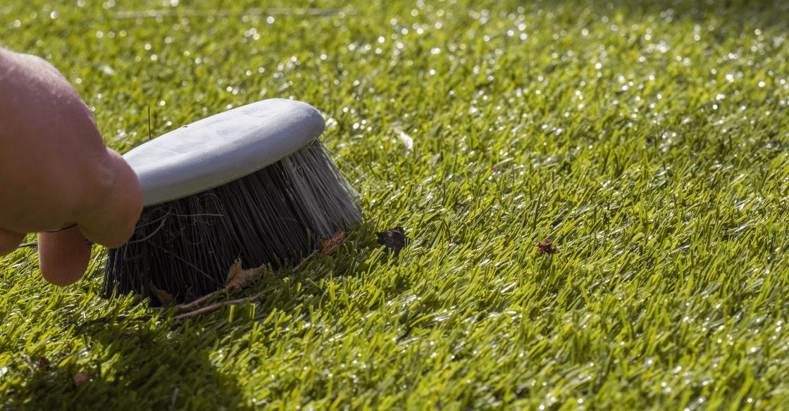 Brushing artificial turf
