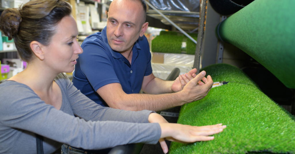 Salesperson helping a woman choose the right turf type
