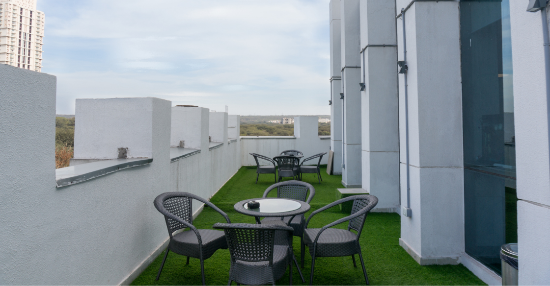 apartment building dining area with artificial turf